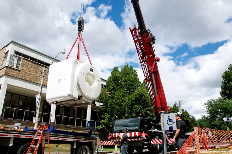 A crane lifts the MRI