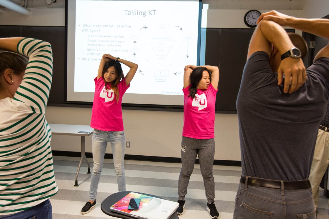 MoveU instructors lead a classroom movement break