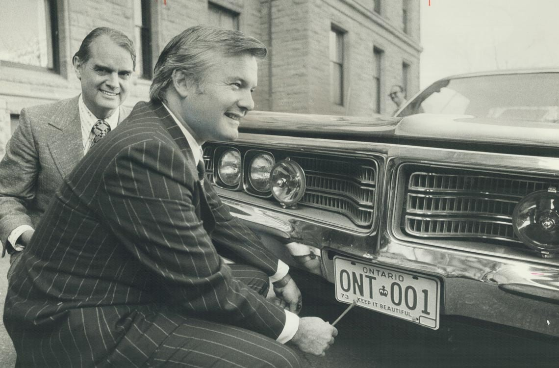 Former Ontario Premier William Davis with the first renewable license plate