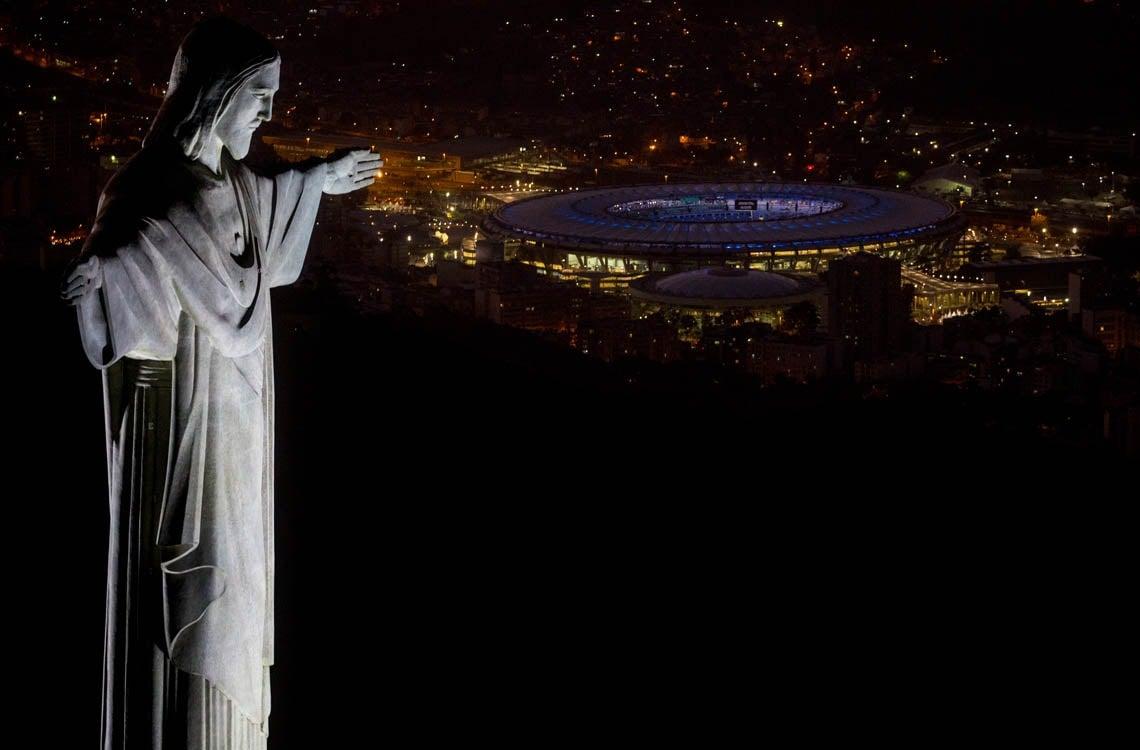 Statue of Christ the Redeemer overlooks Rio de Janeiro's Maracana Stadium