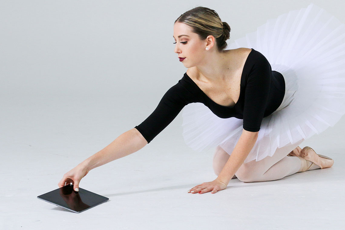 The StageKeep dance app is illustrated with a photo of a kneeling ballet dancer reaching for a tablet computer