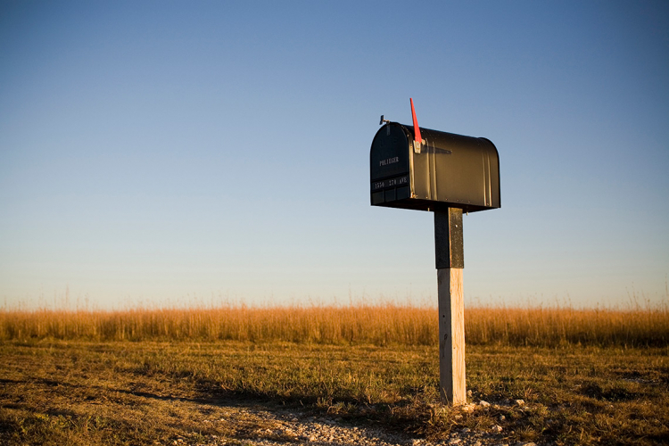 photo of a mailbox in a field