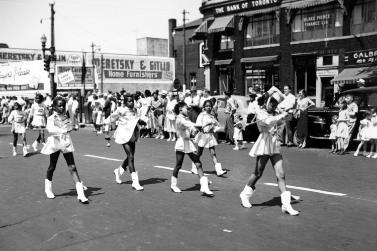archival image of young black cheerleaders in an emancipation day parade in windsor, on