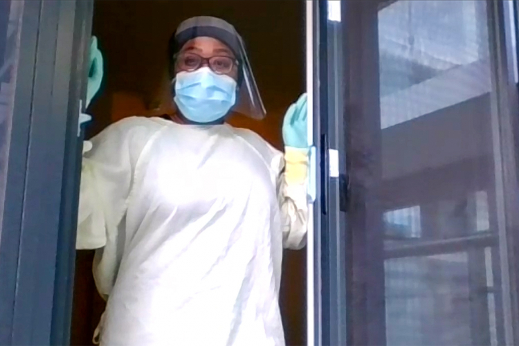 Mariah Douglas in full PPE at her home balcony
