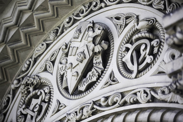 Carved stonework above University College doors