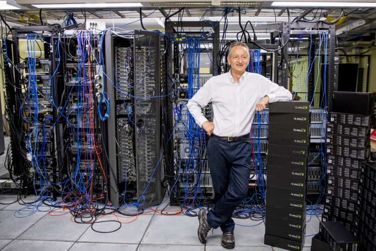 Geoffrey hinton stands in a server room