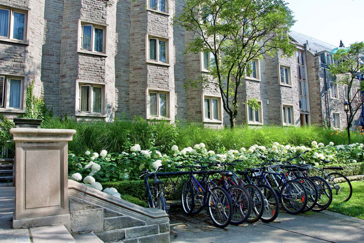 Photos of bicycles locked up outside of a building on campus