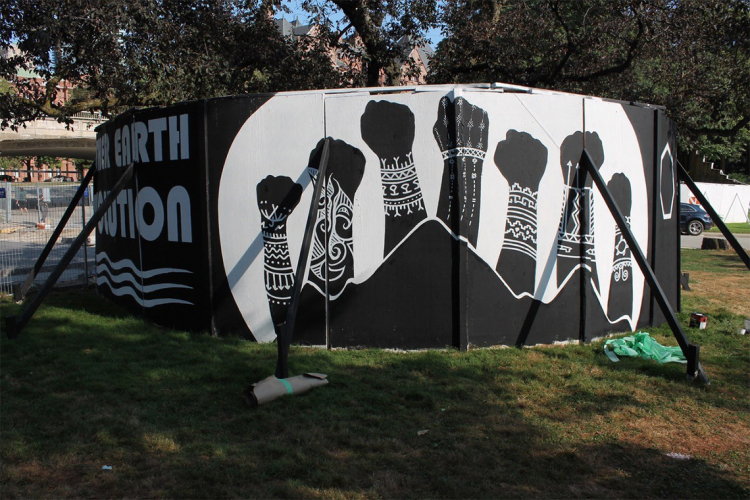 Painting by Onaman Collective on the Hart House TPZ hoardings