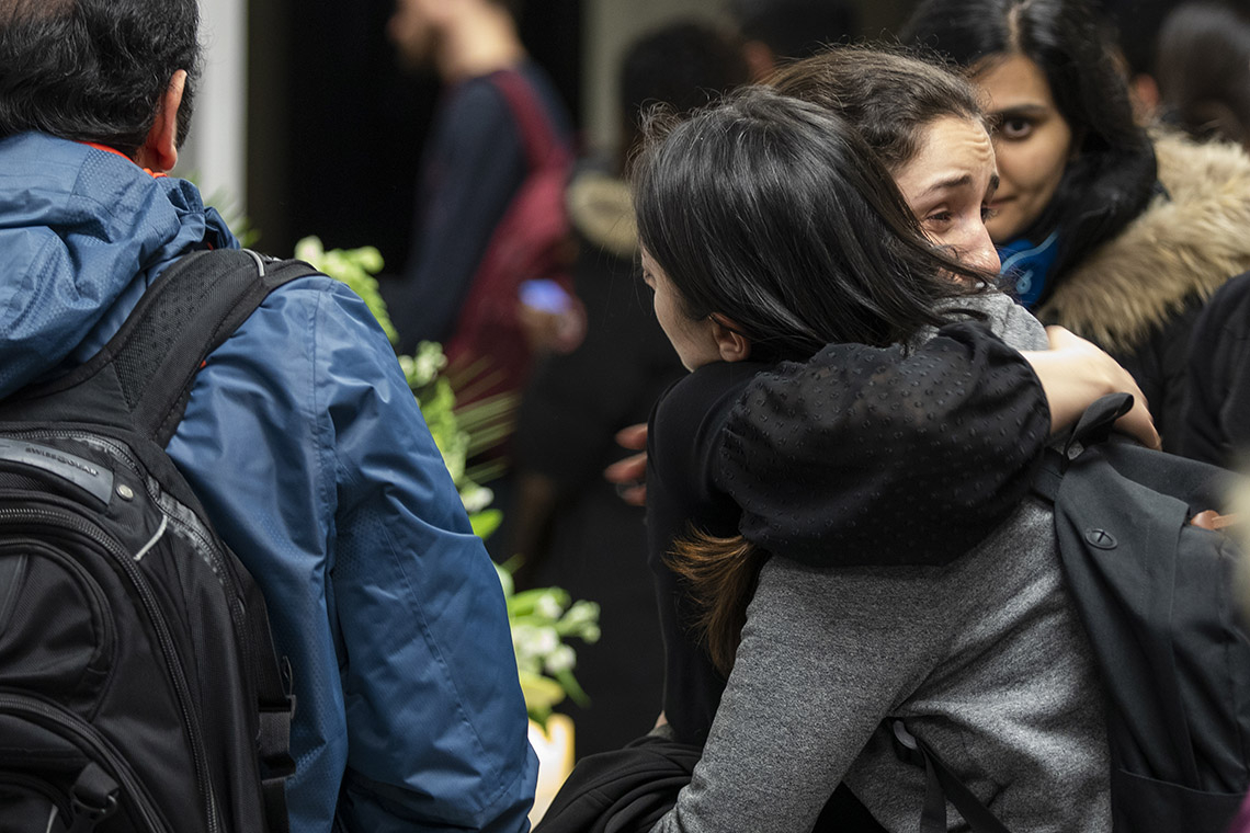 Two women embrace at the vigil for the U of T victims of the ukranian air plane crash
