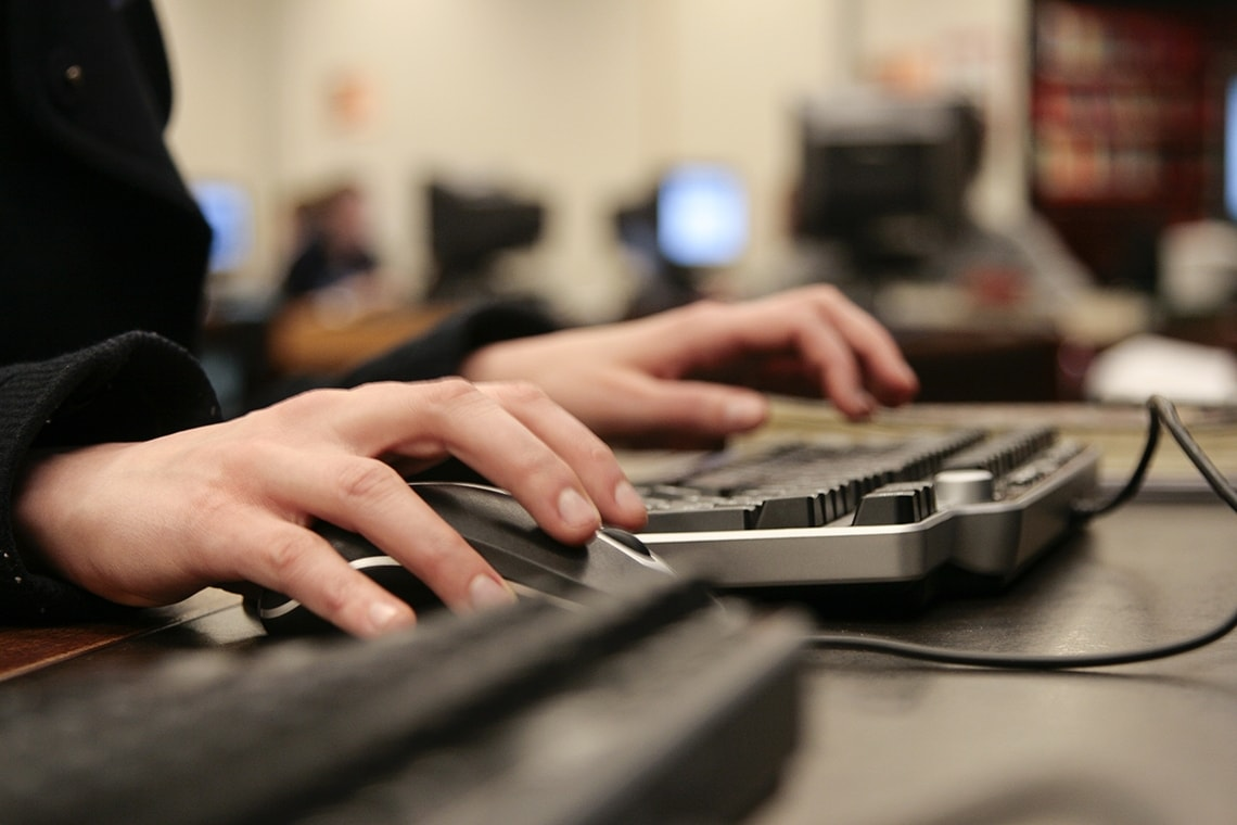 photo of hands at a computer keyboard