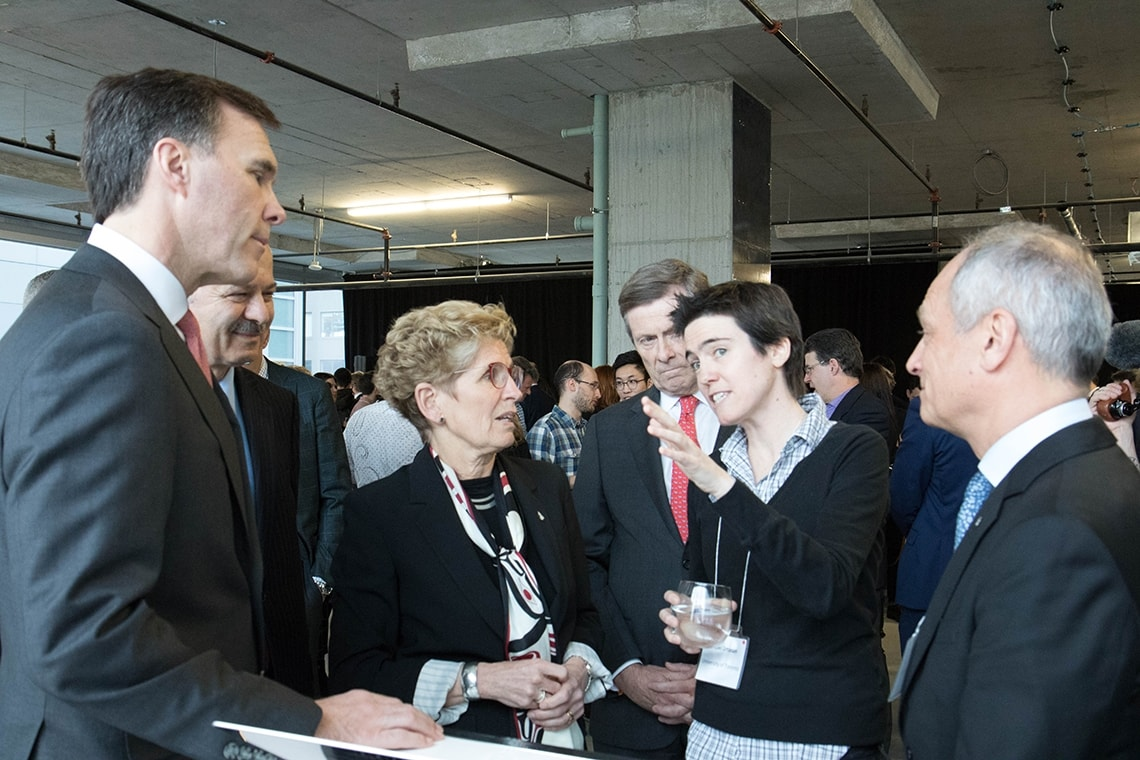 photo of researchers and president