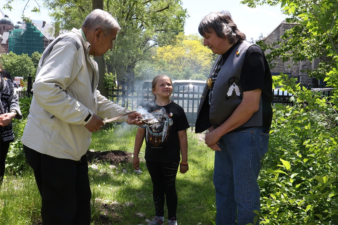 Elder Andrew Wesley, Roy Strebel and Roy's daughter during the garden's opening ceremony