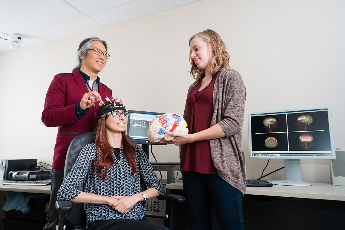 Photo of Tom Chau and two graduate students