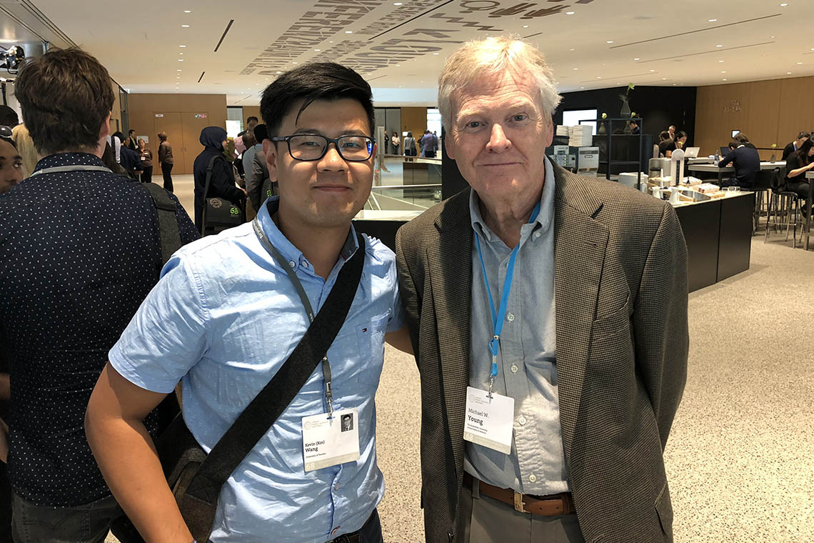 Photo of Kevin Wang with Nobel Laureate Michael Young