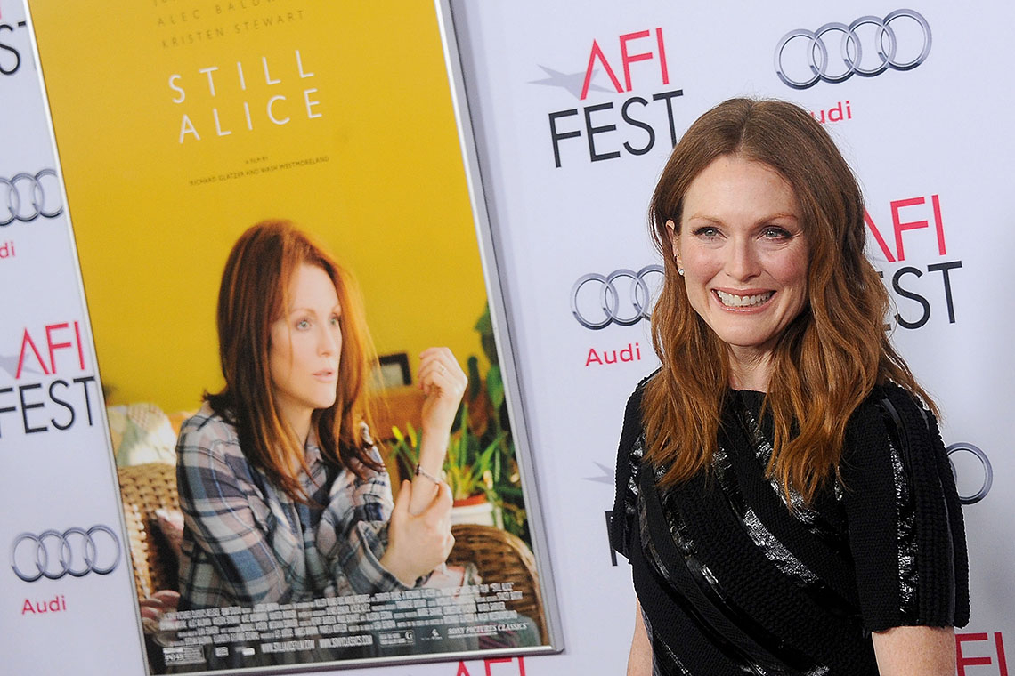 Photo of Julianne Moore and Still Alice poster
