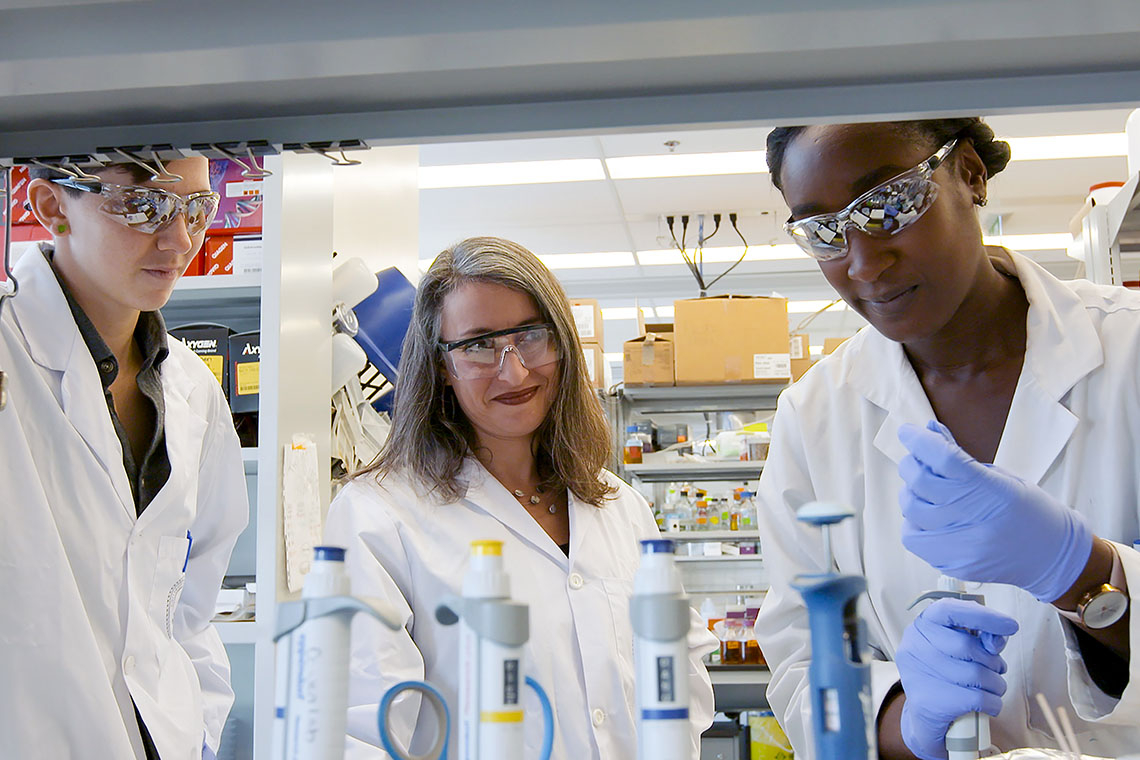 Photo of Leah Cowen and other researchers in lab