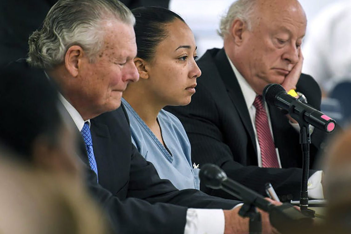 Photo of Cyntoia Brown and lawyers
