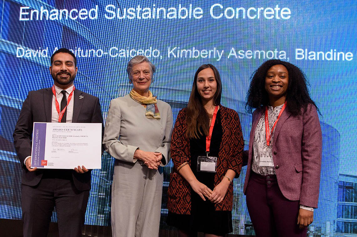 Kimberly Asemota (far right), Blandine Barthod (right) and David Aceituno-Caicedo (left) receive the SDSN Youth Special Prize in Geneva from Nane Annan, a lawyer and wife of the former UN secretary general