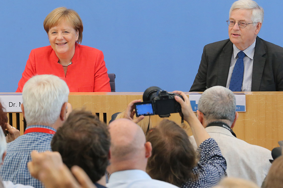 Photo of Angela Merkel and Gregor Mayntz