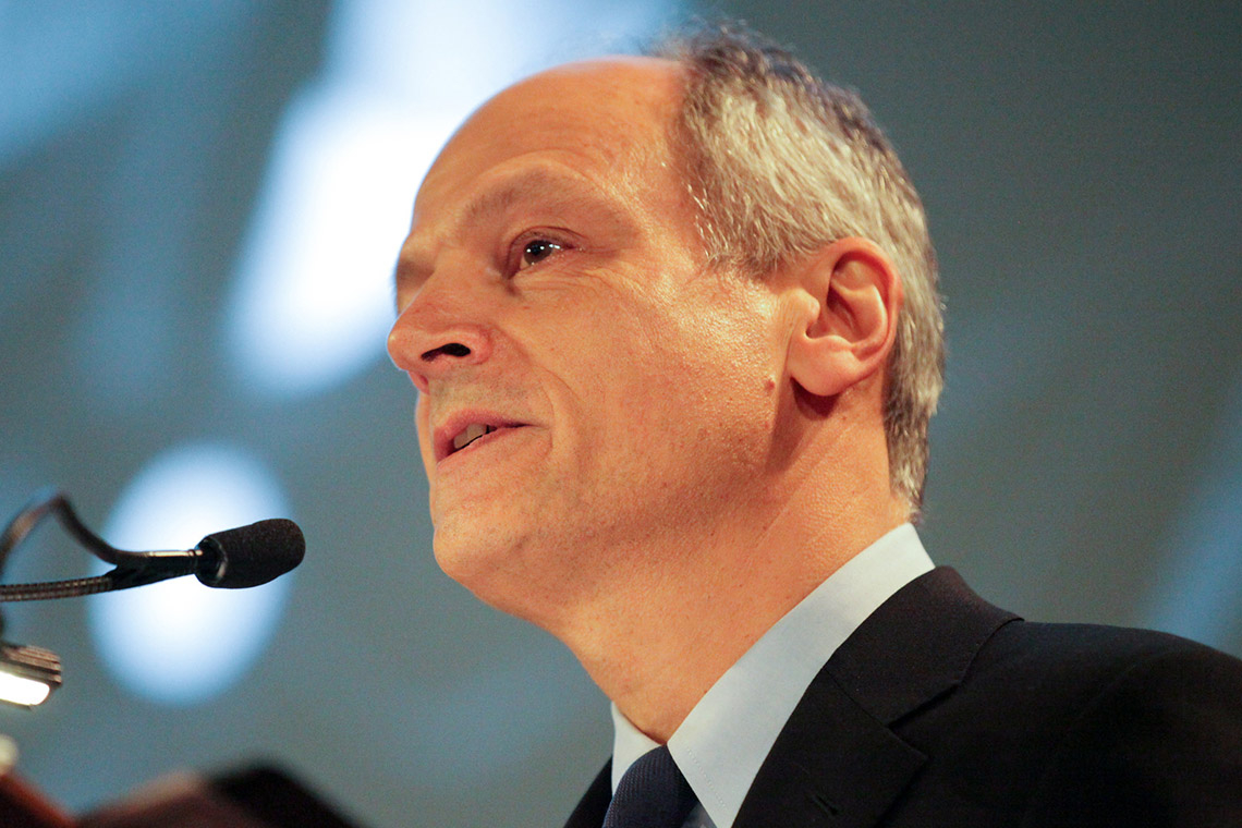 Meric Gertler speaking at a podium