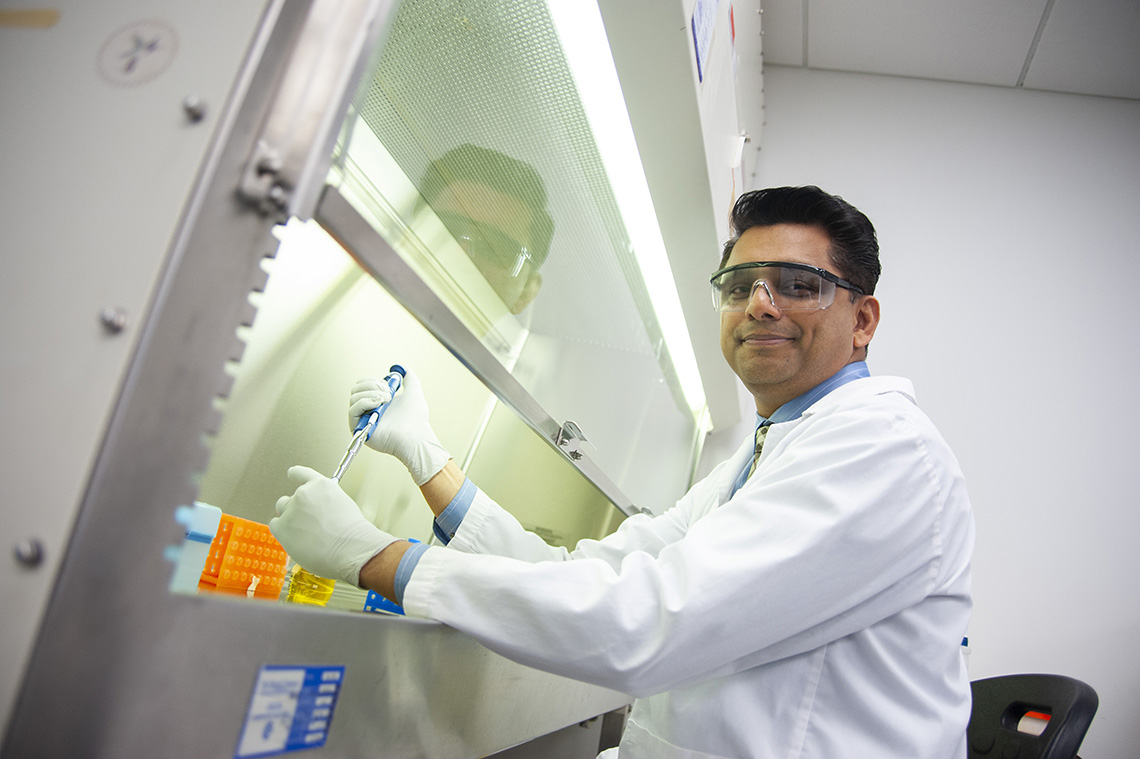 Anil Kishen working under a fume hood in a laboratory