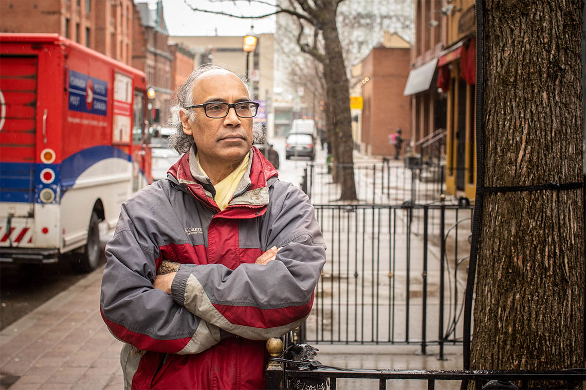 Portrait of Kumar Murty taken at street level outside of his elm st office
