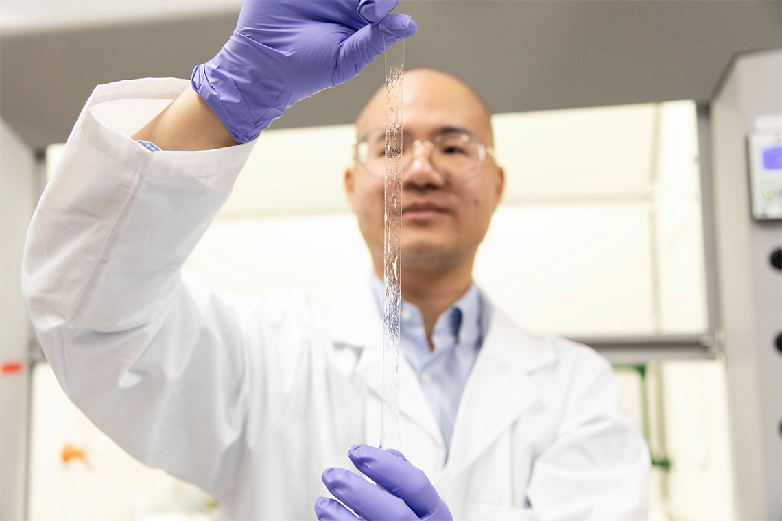 Photo of Binbin Ying demonstrating the AISkin technology in the lab