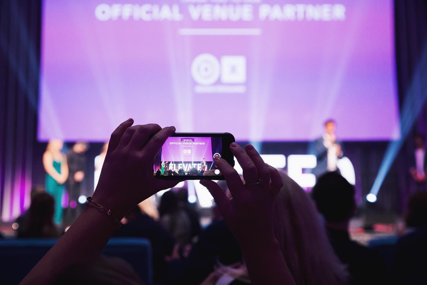 an attendee takes a photo of the main stage at the elevate ai festival in 2018