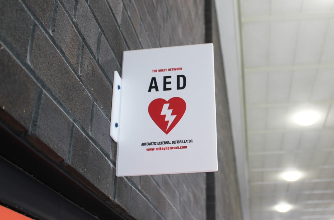 A sign showing the location of an Automated External Defibrillator
