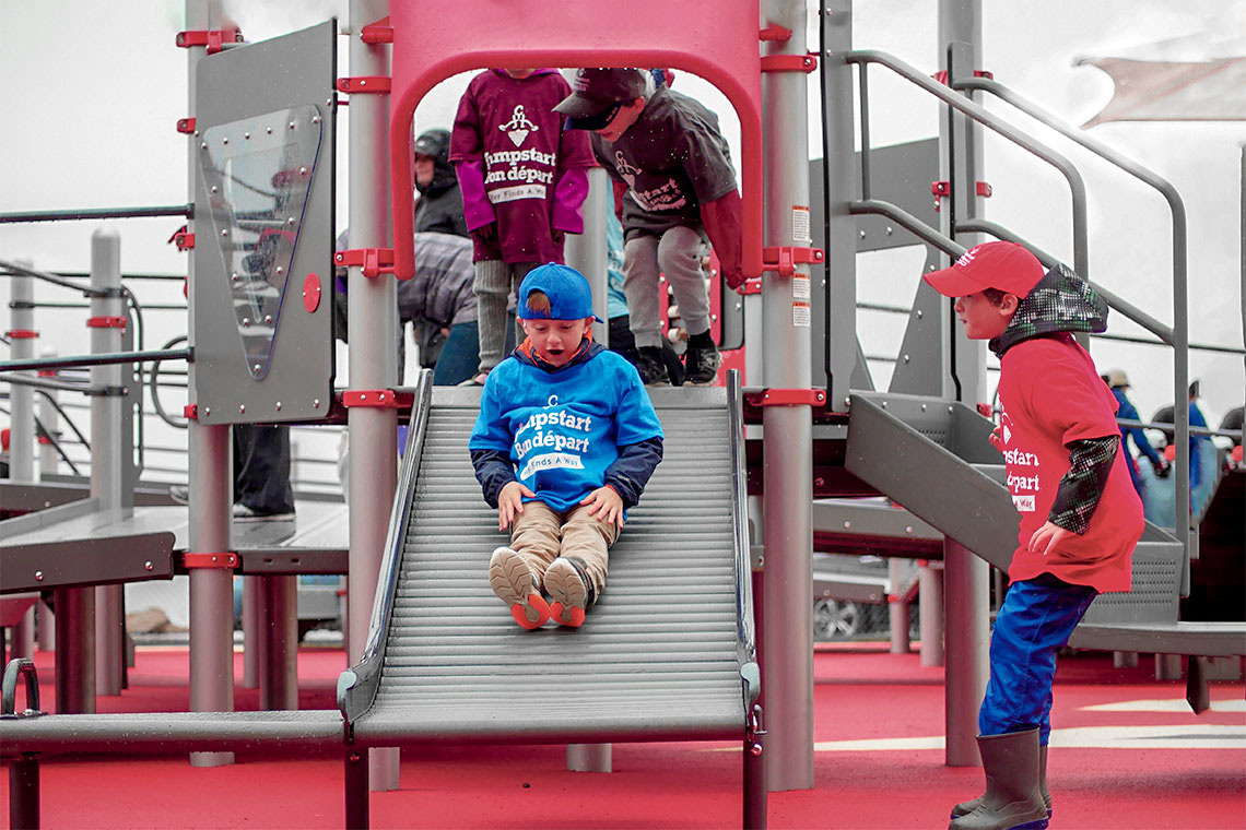 Children using an accessible playground built in Charlottetown, PEI