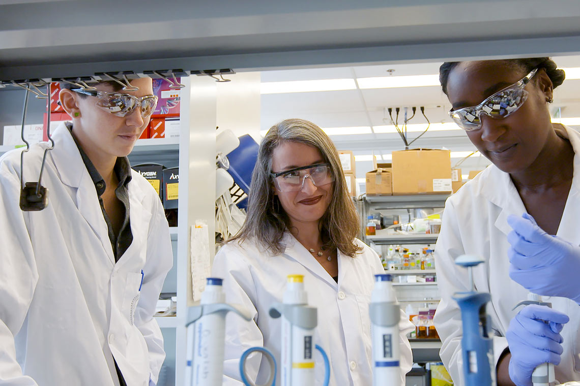 photo of Leah Cowen and other female researchers in a lab