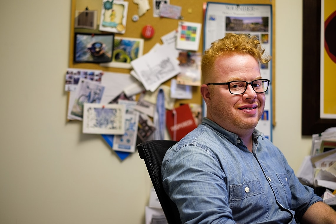 A picture of David Roberts, assistant professor of urban studies, in his office