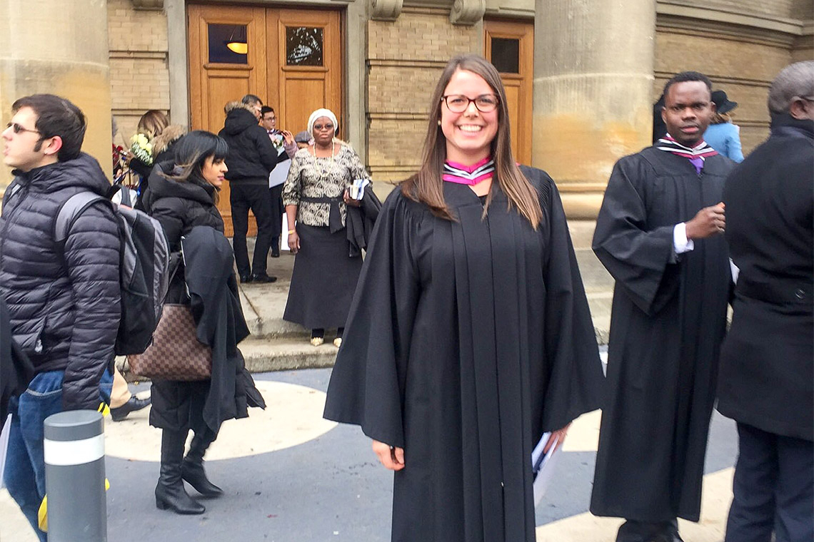 Erica Gavel outside Convocation Hall in her graduation robes