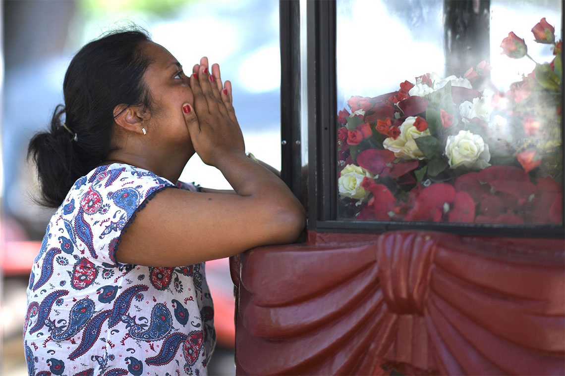 Woman praying after Sri Lanka attack