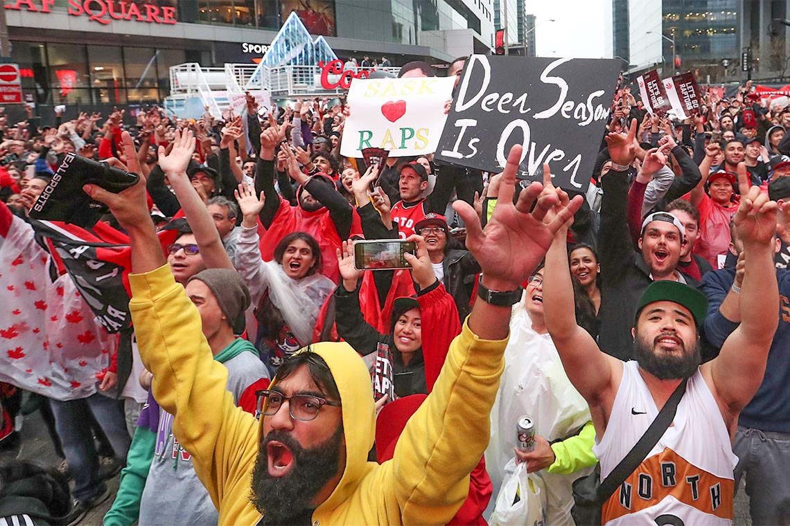 Fans cheering in Jurassic Park otherwise known as Maple Leaf Square, after the Raptors beat the Milwaukee Bucks