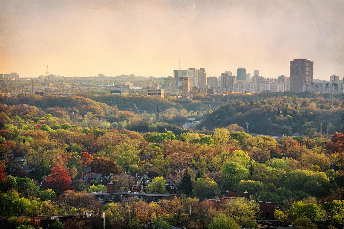 Don Valley in Toronto looking northwards. Fall foliage is visible and there is haze in the air