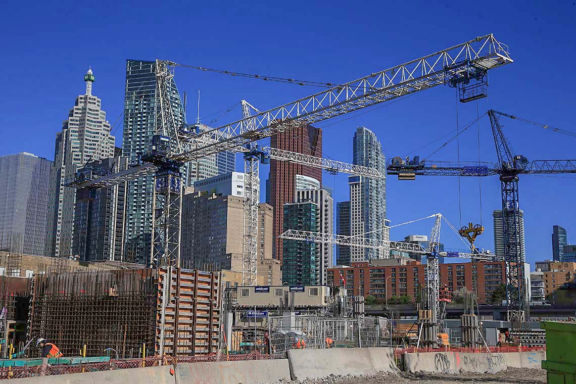 Construction cranes dot the downtown Toronto skyline