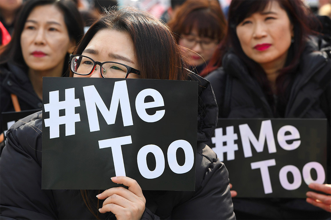 South Korean demonstrators hold banners during a rally to mark International Women's Day