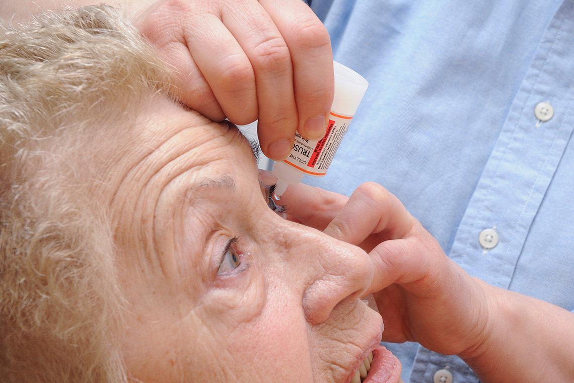 Photo of a glaucoma patient receiving eye drops