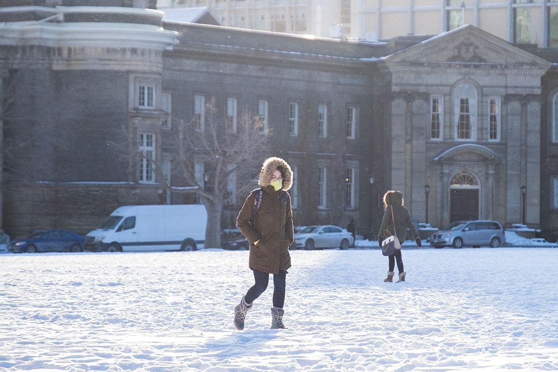 Student walking across front campus