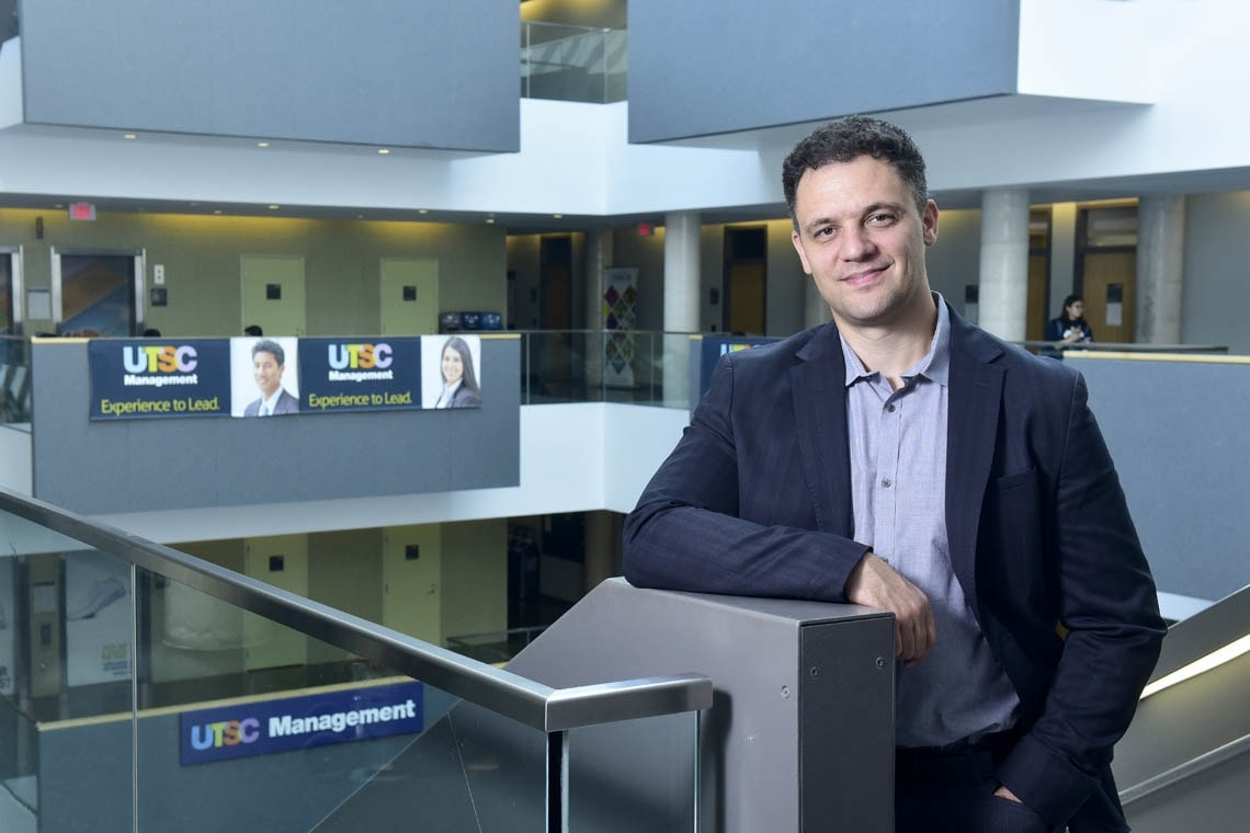 John Trougakos stands inside a building at University of Toronto Scarborough