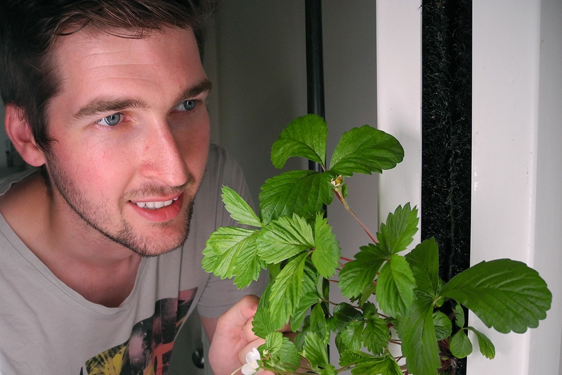 photo of alumnus with plant