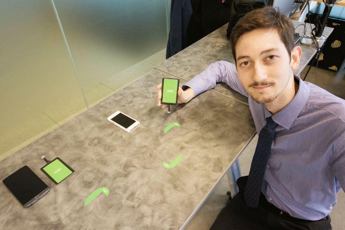 photo of grad with his device