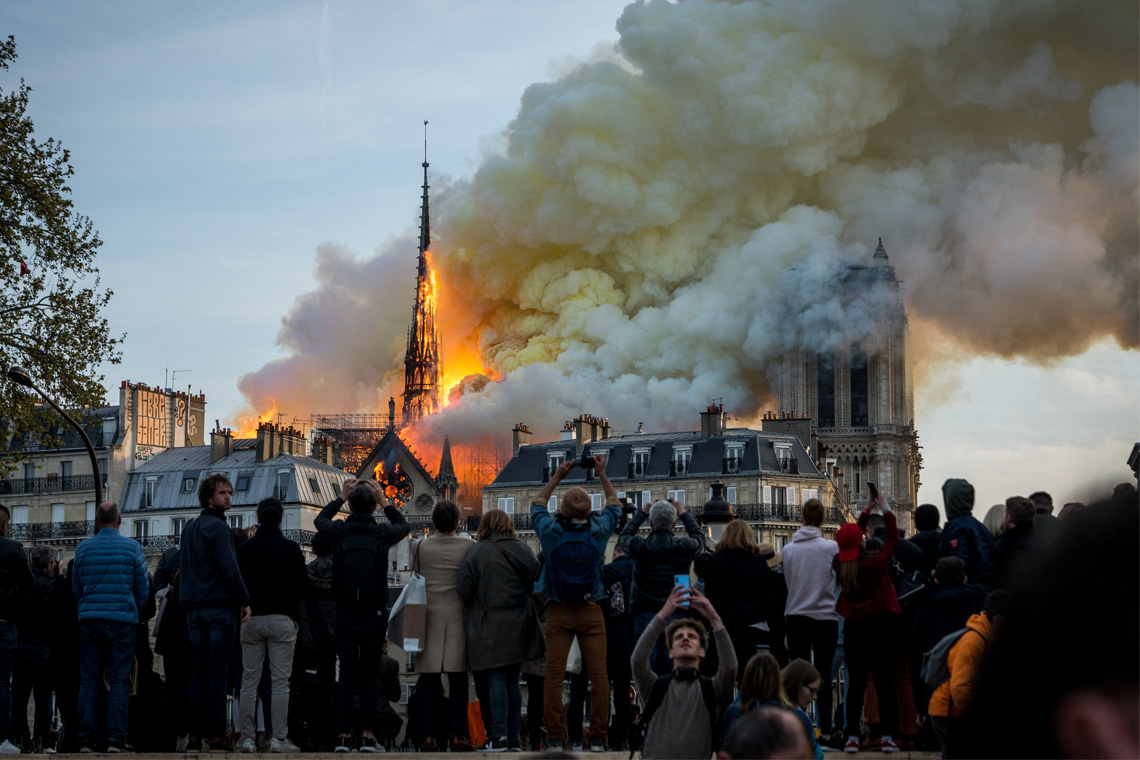 photo of the Notre Dame Cathedral in Paris as the roof burns