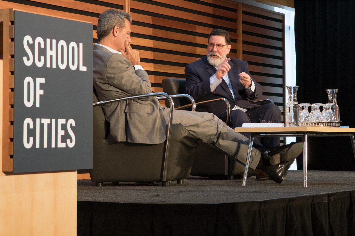 Photo of Richard Florida and Pittsburgh Mayor Bill Peduto on stage