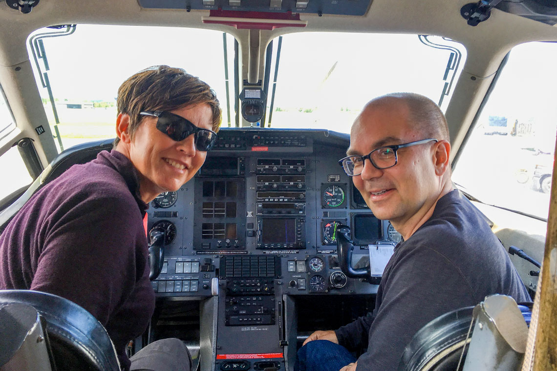 Tracey Galloway and Chris beck in the cockpit of a plane