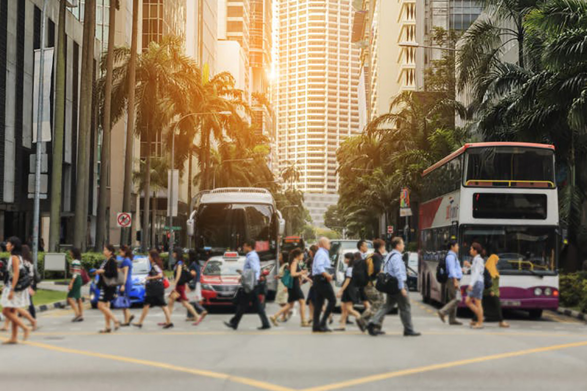 Photo of pedestrians crossing the street in Singapore