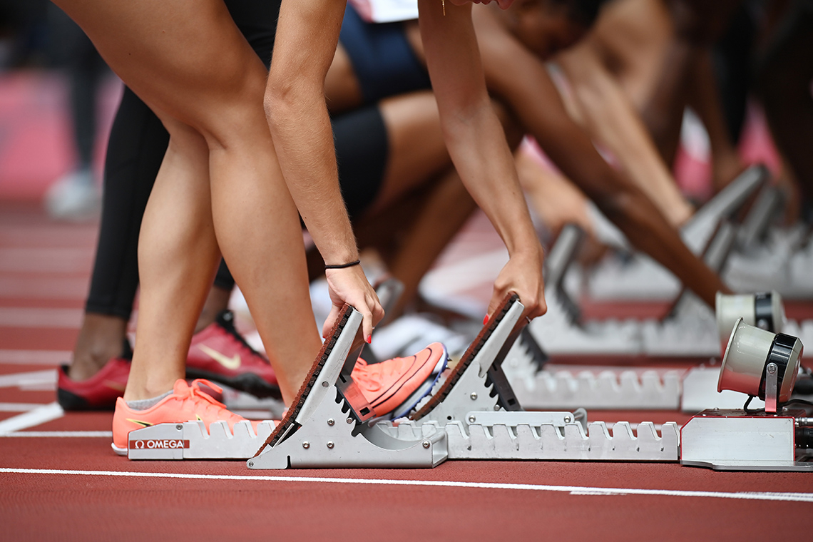 Runners line up in the starting block at the Tokyo Games