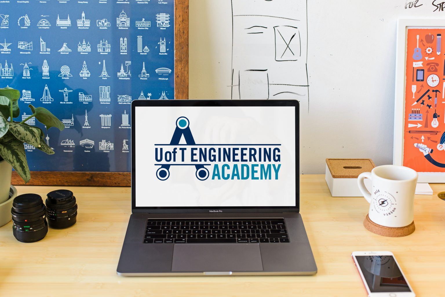 A laptop sitting on a desk with the U of T Engineering Academy landing page displayed on the screen