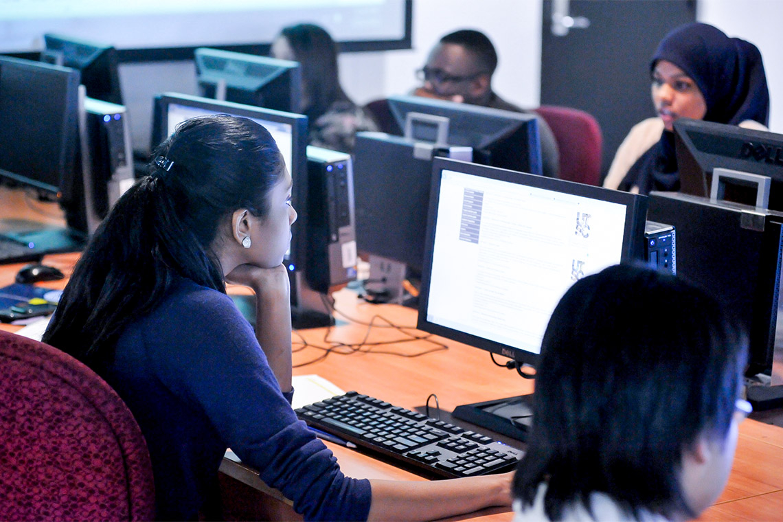 students looking at computer screens in a computer lab